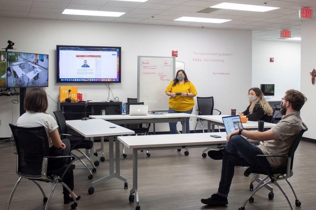 Monique leading team meeting