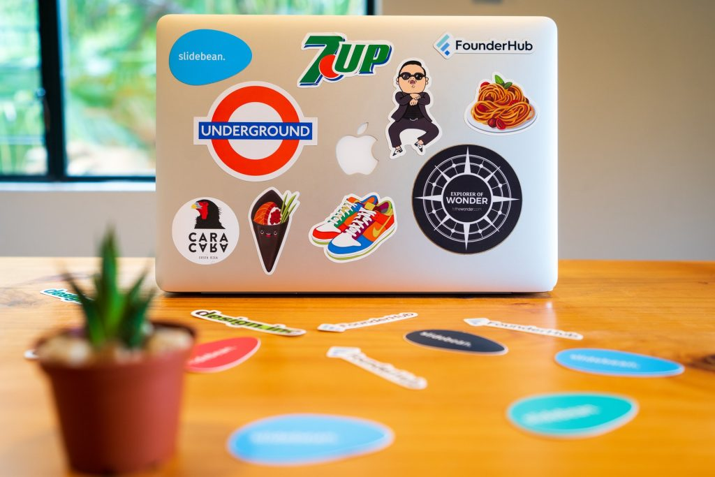 logo stickers on Macbook and table